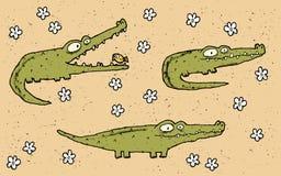 Sistema dibujado mano del ejemplo del grunge de tres cocodrilos lindos en f Fotografía de archivo libre de regalías