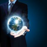 Sistema do planeta em suas mãos Fotografia de Stock