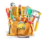 Sistema grande de herramientas de la construcci?n en la correa amarilla de la herramienta aislada en blanco fotografía de archivo