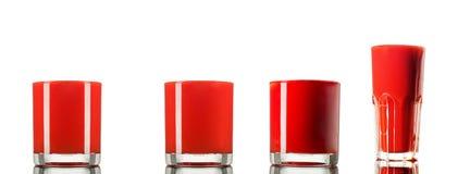 Sistema hecho del jugo de tomate 4 en el vidrio aislado en el fondo blanco Fotografía de archivo libre de regalías