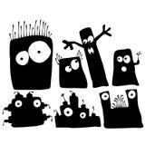Sistema negro de la etiqueta engomada de la historieta de los monstruos y de los robots de la silueta aislado fotografía de archivo