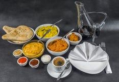 Sistema oriental del indio, pollo Korma, masala del tikka del pollo, pilaf Fotografía de archivo