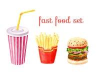 Sistema, patatas fritas, hamburguesa y taza de los alimentos de preparación rápida Imágenes de archivo libres de regalías