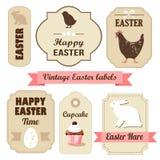 Sistema retro lindo de pascua de etiquetas con los huevos, el pollo, el conejito, las cintas y otros elementos, ejemplo Imagen de archivo libre de regalías