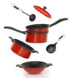 Sistema rojo del cookware fotografía de archivo