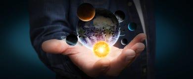 Sistema solare della tenuta dell'uomo d'affari in sua mano illustrazione vettoriale