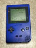 Sistema tenuto in mano portatile blu d'annata del video gioco Immagini Stock