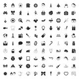 Sistema universal del Año Nuevo de los iconos de la Navidad 100 para el web y el móvil Imágenes de archivo libres de regalías