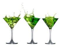 Sistema verde del cóctel del alcohol con el chapoteo en blanco imágenes de archivo libres de regalías