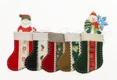 Sistemi del calzino di Natale con l'uomo della neve e di Santa immagini stock