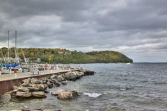 Sister Bay Wisconsin Marina looking out to the Peninsula. The peninsula in fall as the colors are beginning to emerge, from the Sister Bay Wisconsin Marina Stock Photos