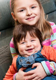 Sister and brother. Older sister holding her younger baby boy brother portrait royalty free stock image