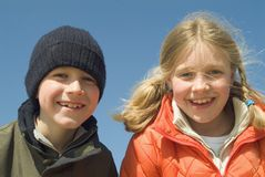 Sister and brother on the beach. (blue sky Royalty Free Stock Photos