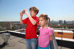 Sister, brother with camera photo city Stock Images