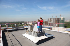 Sister, brother with camera standing on roof. Of high building,  brother photo Stock Photography