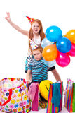 Sister and brother celebrates birthday. Redhead sister and brother celebrates birthday royalty free stock image