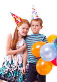 Sister and brother celebrates birthday. Redhead sister and brother celebrates birthday royalty free stock photography