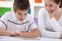 Sister and brother with digital tablet Royalty Free Stock Photo