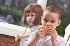 Sister and Brother Eating an Apple Stock Images