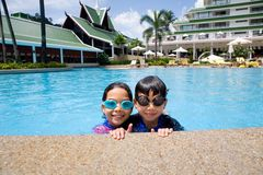 Sister and brother enjoying the pool Stock Images