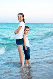 Sister and brother on the evening beach. Happy family. Stock Photo