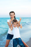 Sister and brother on the evening beach. Happy family. Stock Images