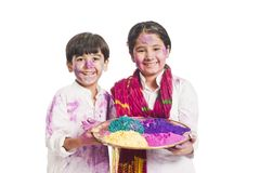 Sister and brother holding color plate Royalty Free Stock Photo