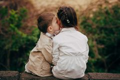 Sister and brother hugging kissing Stock Photos