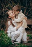 Sister and brother hugging Stock Photography