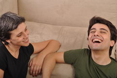Sister and brother laughing Stock Images