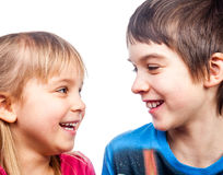 Sister and brother laughing Royalty Free Stock Photos