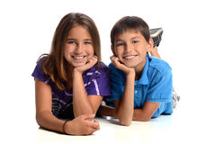 Sister and Brother Laying Stock Image