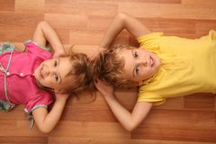 Sister and brother lie on floor royalty free stock photo