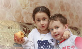 Sister and brother. Little children, brother and sister, with an apple Royalty Free Stock Image