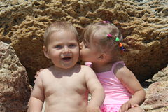 Sister and brother. Little girl kissing a boy Royalty Free Stock Photos