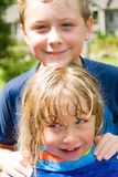 Sister and Brother Love. A young sister and brother, they've been swimming and now are acting silly Stock Photo