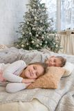 Sister and brother lying on bed Stock Images