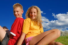 Sister and brother outdoors Stock Photos