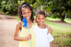 Sister and brother with pinwheel. Happy sister and brother with pinwheel outdoors Royalty Free Stock Photos