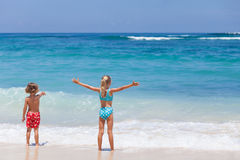 Sister and brother playing on the beach at the day time. Stock Image