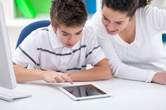 Sister and brother playing game on tablet pc Royalty Free Stock Image