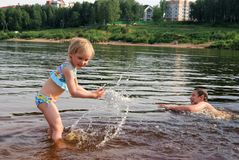 Children playing in the river. Sister and brother playing in the river Stock Photo