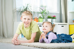 Sister and brother playing in a room Stock Photos