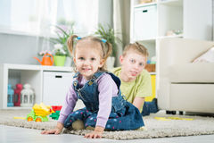 Sister and brother playing in a room Royalty Free Stock Image
