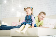 Sister and brother playing in a room Stock Images