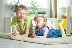 Sister and brother playing in a room Royalty Free Stock Images