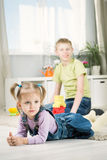 Sister and brother playing in a room Stock Photography