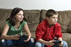 Sister and brother playing a video game Royalty Free Stock Photo