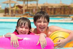 Sister and brother in pool Stock Image