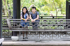 Sister and brother portrait. Sister and brother talking together at the park stock image